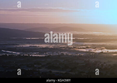 The view as the sun rises over Worcestershire, as seen from the Malvern Hills. - Stock Photo