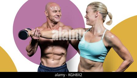 Digital composite of Fitness trainer man with minimal shapes training strong woman - Stock Photo