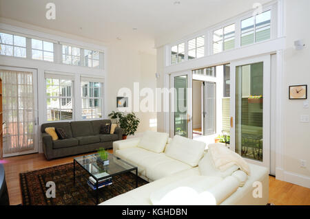 Lining room and atrium in modern open floor plan townhouse apartment - Stock Photo