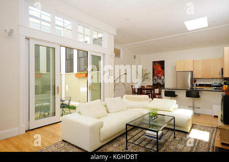 Open floor plan. Living room, dining room, kitchen and atrium in modern home apartment, furnished, spacious, with - Stock Photo