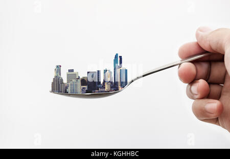 Real estate buildings on the spoon, isolated on white background. Real estate concept - Stock Photo
