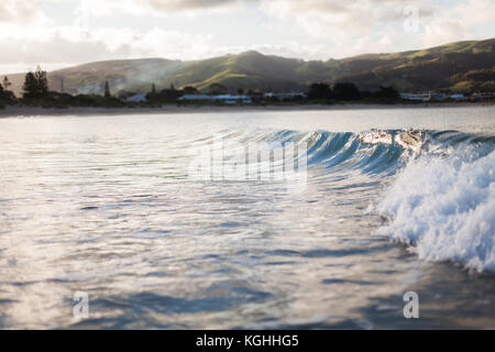 A wave breaking at Apollo Bay, located on the Great Ocean Road, Victoria - Stock Photo