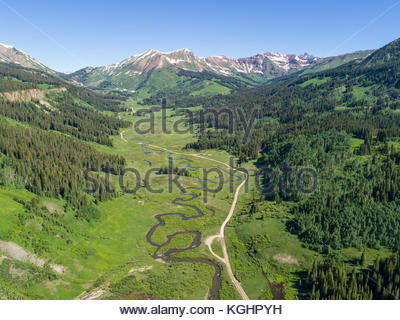 The East River and Gothic Road run through the valley from Gothic toward Belleview Mountain. - Stock Photo