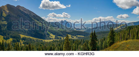 Summer panorama looking east down Washington Gulch toward Crested Butte Mountain in Colorado. - Stock Photo