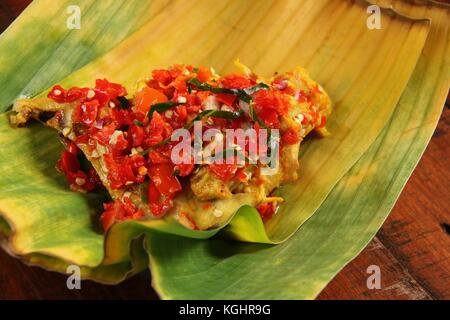 Ayam Balado, Padang Chicken with Crushed Red Chili Peppers - Stock Photo