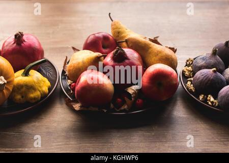 ripe autumn fruits on table - Stock Photo