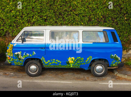 VW camper with flower decorations parked along side of the Strada Provinciale 227 di Portofino 2017 - Stock Photo