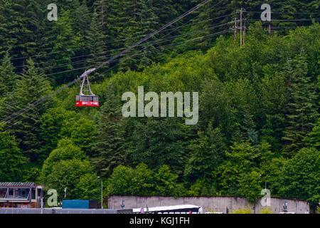 A cable-car ascends up Mt. Roberts in Juneau, Alaska. - Stock Photo