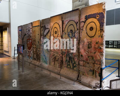 A large section of the Berlin Wall on display in Newseum, an interactive museum in Washington DC, United States. - Stock Photo