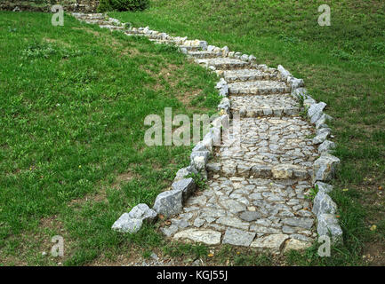 Stone stairs leading to top of the hill - Stock Photo