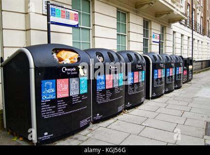 Recycling bins for assorted recyclable waste, Gillingham Street, London, England, UK - Stock Photo