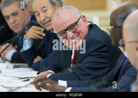 Magas, Russia. 7th Nov, 2017. Algeria's Ambassador to Russia Smail Allahua (C) smiles during a meeting as a delegation - Stock Photo