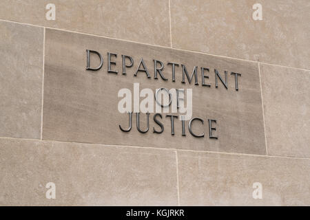WASHINGTON, DC - JULY 12: United States Department of Justice sign in Washington, DC on July 12, 2017 - Stock Photo