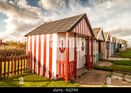 Beach Huts on promenade at Sutton on Sea, east Coast of England October 2017 - Stock Photo