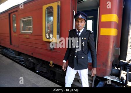 Peradeniya Junction Station Kandy Central Province Sri Lanka Guard by train - Stock Photo