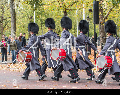 Soldiers of the corps of drums 1st battalion Coldstream guards march out of St James palace and along the Mall after - Stock Photo