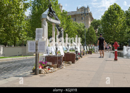 Memorial next to interactive fountain in Budapest Hungary. - Stock Photo