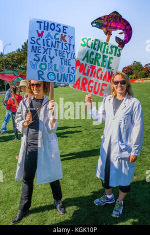 Science vs politics. Climate change knows no borders. International rally at Peace Arch border crossing. - Stock Photo