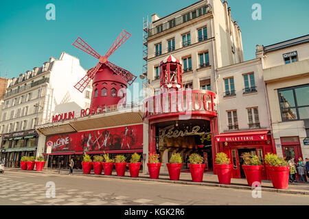 Paris, France, March 31 2017: Moulin Rouge is a famous cabaret built in 1889, locating in the Paris red-light district - Stock Photo
