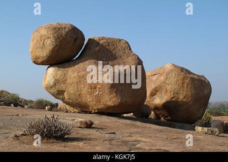 Big granite boulder popular for rock climbing. Unique landscape in Hampi, India. - Stock Photo