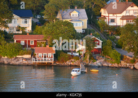 Traditional wooden houses village on finland coastline at sunset. Horizontal - Stock Photo