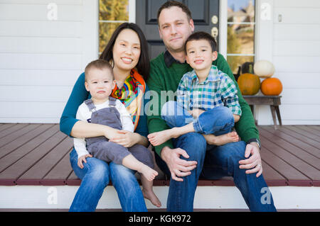 Mixed Race Chinese and Caucasian Young Family Portrait - Stock Photo