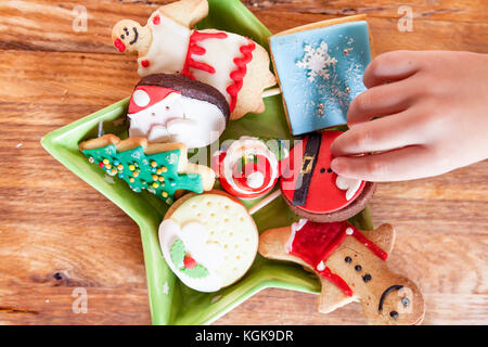 mixed with homemade Christmas cookies over a wooden background - Stock Photo