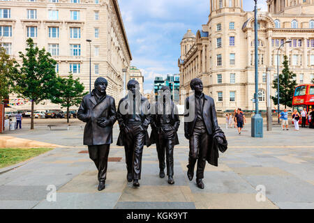 Bronze statue of the four Liverpool Beatles stands on Liverpool Waterfront by sculptor Andrew Edwards. - Stock Photo