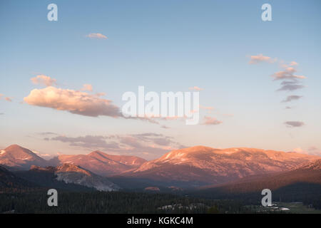 A view to Tuolumne Meadows and nearby mountains from Pothole Dome at sunset. - Stock Photo