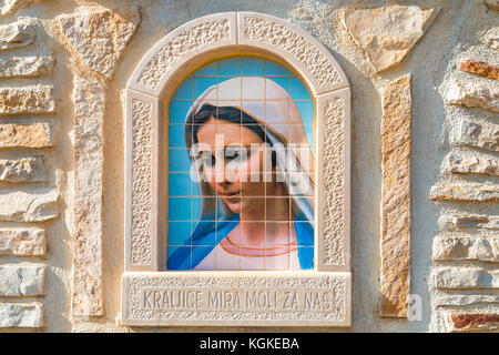 MEDJUGORJE, BOSNIA AND HERZEGOVINA - NOVEMBER 5:  painting of Our Lady of Medjugorje, a popular destination for - Stock Photo