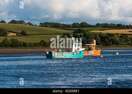 Small inshore fishing boats at anchor on the Teifi river estuary at Gwbert , near Cardigan, Ceredigion, Wales, UK - Stock Photo
