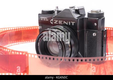 Old Soviet Zenit TTL 35 mm film camera isolated on white - Stock Photo