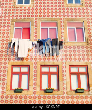 Traditional Porto house decorated with tile and typical Portugues way of drying clothes. Portugal - Stock Photo