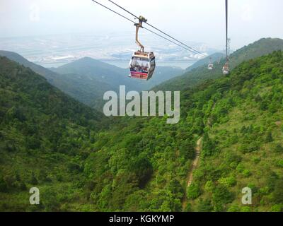 going up with the cable car in Hong Kong to the world's biggest Buddha statue - Stock Photo