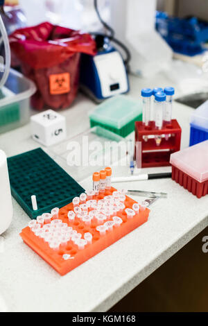 High angle view of various scientific equipment on table at laboratory - Stock Photo