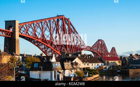 View of North Queensferry and the famous Forth Rail Bridge  spanning the Firth of Forth between Fife and West Lothian - Stock Photo