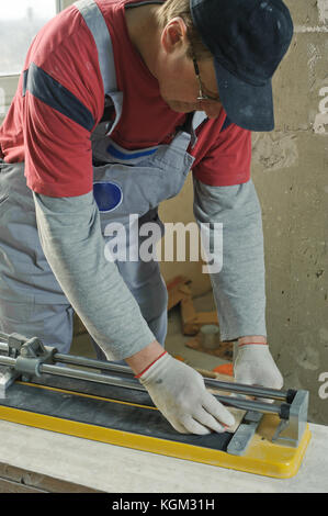 Renovation At Home Worker Cuts Tile With Angle Grinder Electric Tool