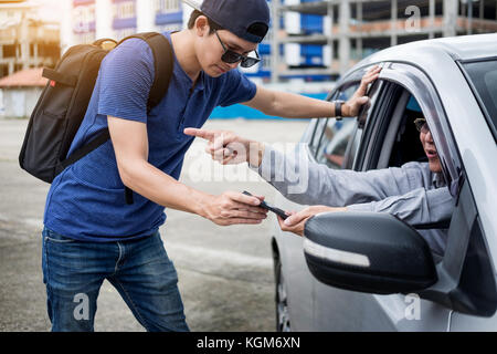 tourists or traveler seek advice map with smart phone from taxi drivers - Stock Photo