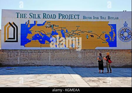 Khiva, Uzbekistan. Tourists at the Silk Road map. 13 of September 2017 - Stock Photo