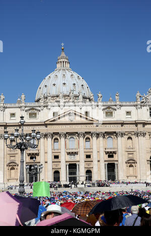 Crowd standing by Saint Peter's Basilica in Rome, Italy - Stock Photo