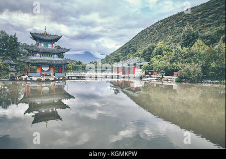 Jade Spring Park in Lijiang, retro color toned picture, China. - Stock Photo
