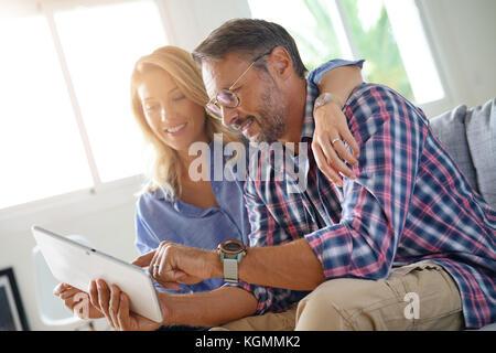 Mature couple buying on internet, online shopping - Stock Photo