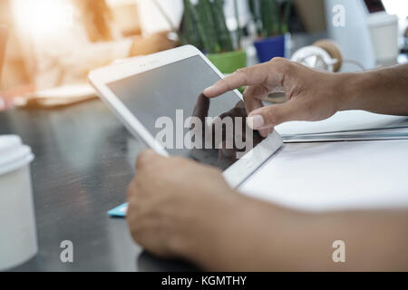 Closeup of man using digital tablet in office - Stock Photo