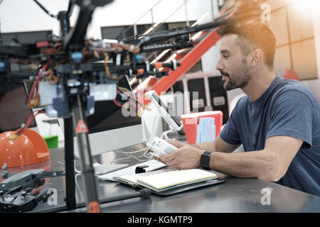 Engineer working on drone in lab - Stock Photo