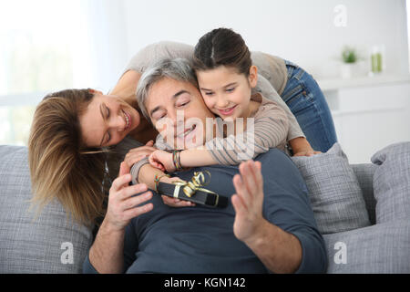 Woman with daughter celebrating father's day - Stock Photo