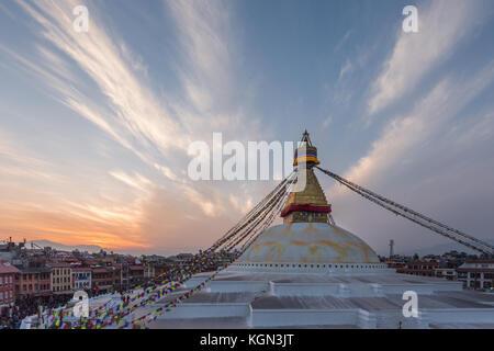 Sunset over Boudhanath stupa in the Kathmandu Valley, Nepal - Stock Photo