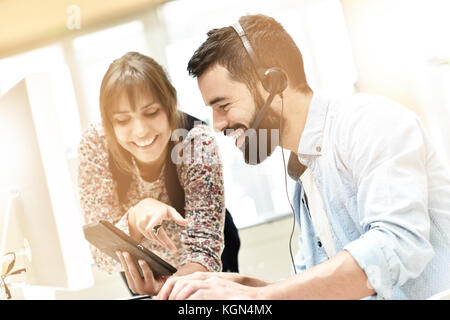 Telemarketing people working together in office - Stock Photo