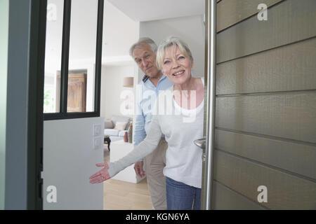 Man opening front door stock photo royalty free image for House friend door