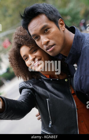 Couple calling for taxi cab in the city - Stock Photo
