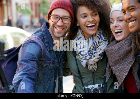 Group of friends on vacation taking selfie picture with camera - Stock Photo